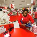 Eva Hopkins, finance supervisor at a Target store in Texarkana, Texas, places money bags in cash registers before the store opens for Black Friday on Thursday night Nov. 22, 2012. Over 1,000 customers waited in line for the store opening at 9 p.m.