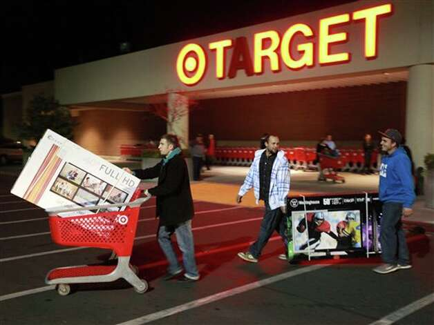 "Trevor Anderson, Mike Van Lone, and Zack McElwain (left to right) walk out with the televisions they purchased at Target, which opened at 9 p.m. as shoppers took advantage of the sales and deals in the earlier shopping period for the typical ""Black Friday"" event on Thursday evening, Nov. 22, 2012 in Chico, Calif. Photo: Jason Halley, AP / MediaNews Group"