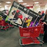 Shopper Lisa Camberos, right, gets a television doorbuster deal at the Target store in Burbank, Calif., on Thursday, Nov. 22, 2012. While stores typically open in the wee hours of the morning on the day after Thanksgiving known as Black Friday, openings have crept earlier and earlier over the past few years. Now, stores from Wal-Mart to Toys R Us are opening their doors on Thanksgiving evening, hoping Americans will be willing to shop soon after they finish their pumpkin pie.