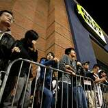 Shoppers stand in line outside a Best Buy department store waiting for the store's opening at midnight for a Black Friday sale Thursday Nov. 22, 2012, in Arlington, Texas.