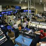"""Long lines of customers snake though the aisles waiting to check out, of the Best Buy store in Tyler, Texas, after it opened at midnight.  Sheriff deputies contolled entry and only 1300 people at a time were allowed in to the store marking the beginning of """"Black Friday"""" with """"door buster"""" special deals, on November 23, 2012."""