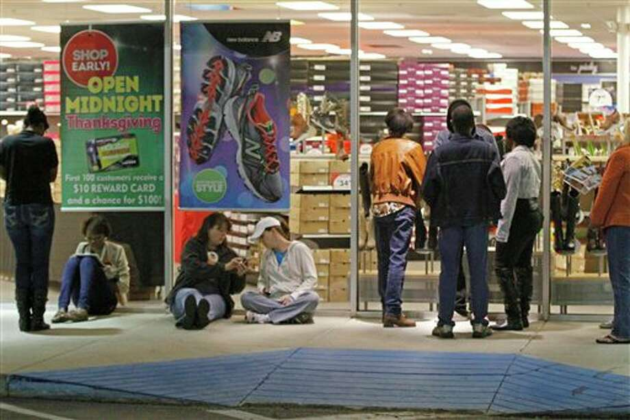 Shoppers line up for a shot at early Black Friday sales, Thursday, Nov. 22, 2012 at a Shoe Carnival store in north Jackson, Miss. Unlike a number of national retailers who have pushed the start of the holiday buying season to sales on  Thanksgiving Day, the store did not open until midnight. Photo: Rogelio V. Solis, AP / AP2012