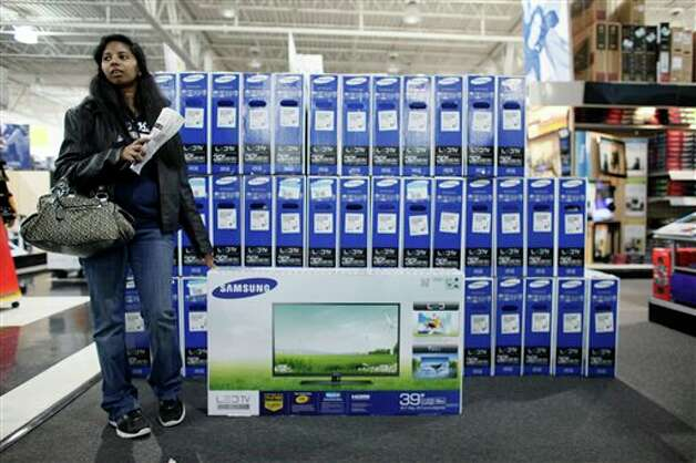 A customer who declined to be identified waits by a television she was purchasing at a Best Buy store, Friday Nov 23, 2012, in Northeast Philadelphia. Photo: Joseph Kaczmarek, AP / AP2012