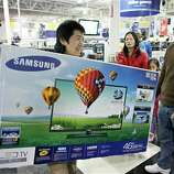 Customers shop for Black Friday discounts at a Best Buy store, Friday Nov 23, 2012, in Northeast Philadelphia.