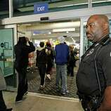 Jackson Police Cpl. Terry Hopkins Sr. watches customers enter Best Buy in Jackson, Miss., for the early Black Friday sales, Friday, Nov. 23, 2012.