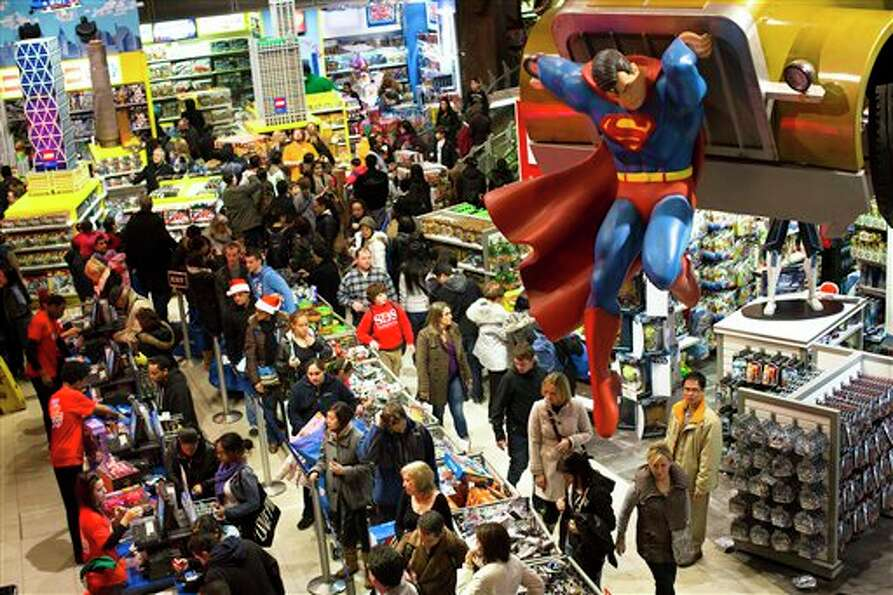 Shoppers wait on a check-out line in the Times Square Toys-R-Us store after doors were opened to the