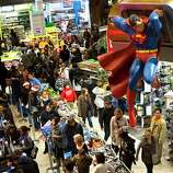 Shoppers wait on a check-out line in the Times Square Toys-R-Us store after doors were opened to the public at 8 p.m. on Thursday, Nov. 22, 2012, in New York. While stores typically open in the wee hours of the morning on the day after Thanksgiving known as Black Friday, openings have crept earlier and earlier over the past few years. Now, stores from Wal-Mart to Toys R Us are opening their doors on Thanksgiving evening, hoping Americans will be willing to shop soon after they finish their pumpkin pie.