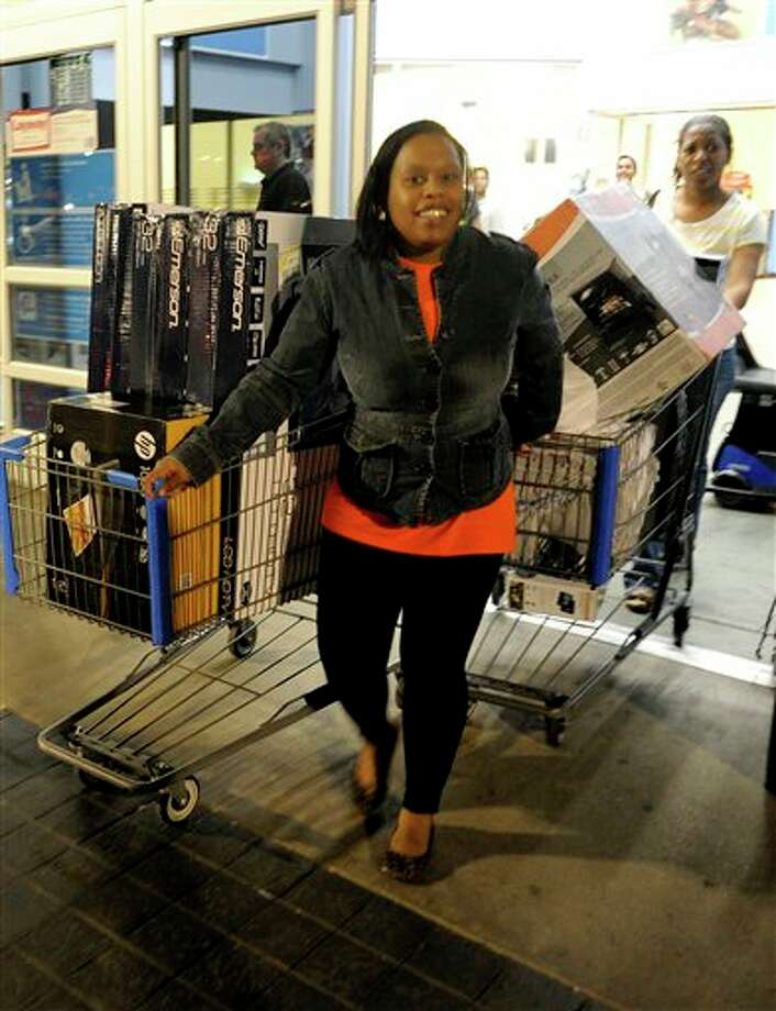Shoppers make their way out of Walmart, Thursday, Nov. 22, 2012 in Dallas. Photo: Matt Strasen, AP / FR170476 AP