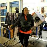 Shoppers make their way out of Walmart, Thursday, Nov. 22, 2012 in Dallas.