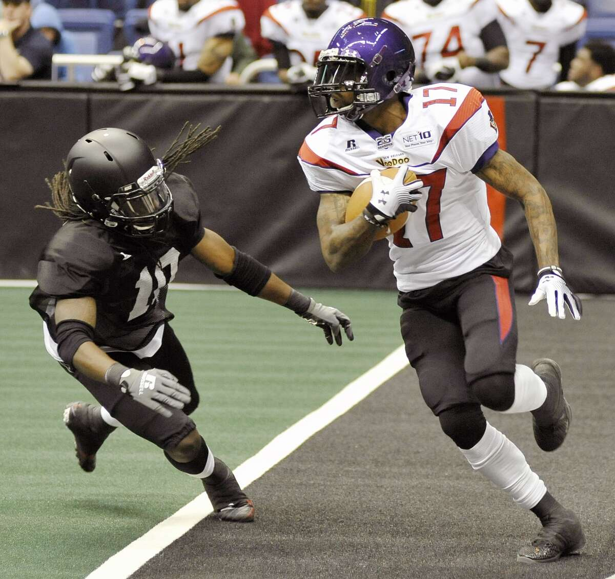 San Antonio Talons' Justin Hanna, left, runs to tackle New Orleans Voodoo's Chris Duvalt during an arena football game, Wednesday, March 6, 2013, at the Alamodome in San Antonio. (Darren Abate/For the Express-News)