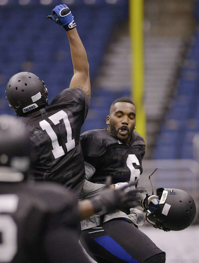 San Antonio Talons' Fred Shaw, right, and Andre Jones, celebrate a touchdown during an arena football game against the New Orleans Voodoo, Wednesday, March 6, 2013, at the Alamodome in San Antonio. (Darren Abate/For the Express-News) Photo: Darren Abate, Darren Abate/SA Express-News