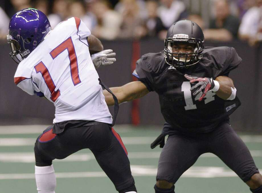 San Antonio Talons' Armahd Lewis, right, runs to tackle New Orleans Voodoo's Chris Duvalt during an arena football game, Wednesday, March 6, 2013, at the Alamodome in San Antonio. (Darren Abate/For the Express-News) Photo: Darren Abate, For The San Antonio Express-News