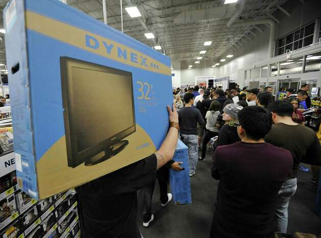 Black Friday shopper Roy Bosquez, left, carries his new television, Friday, Nov. 23, 2012, at Best Buy #201 in San Antonio. Photo: Darren Abate, Darren Abate/For The Express-New