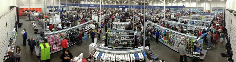 In this 180-degree panoramic photograph, shoppers are seen searching for Black Friday specials, Friday, Nov. 23, 2012, at Best Buy #201 in San Antonio. Photo: Darren Abate, For The Express-News