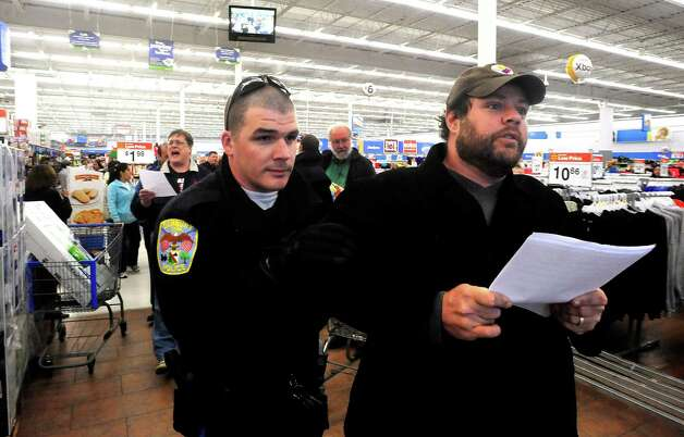 Danbury police remove protesters, including Joe Hill, right, from Wal-mart during a demonstration Friday, Nov. 23, 2012. Photo: Michael Duffy / The News-Times