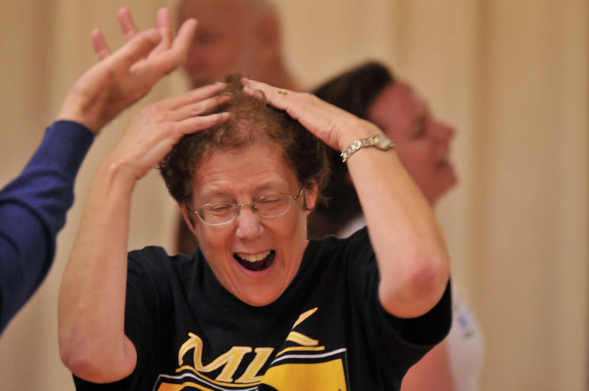 Marianne Kastenbaum laughs during a Laughter Yoga class, which is supposed to relieve stress and improve health.