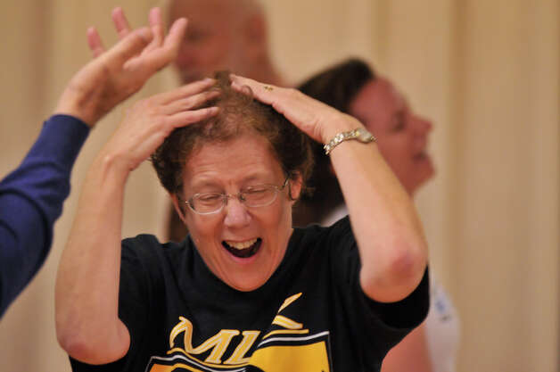 Marianne Kastenbaum laughs during a Laughter Yoga class, which is supposed to relieve stress and improve health. Photo: Robin Jerstad, For The Express-News