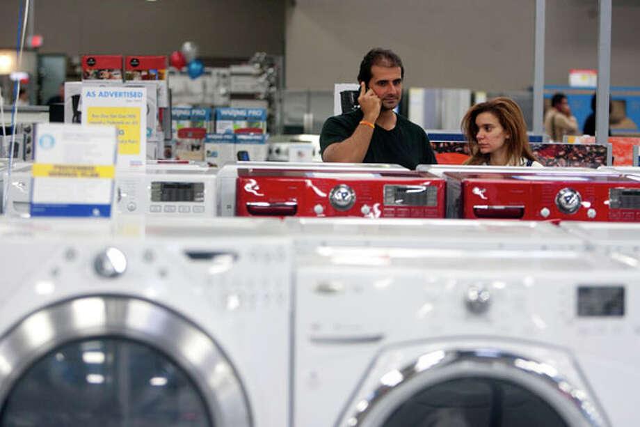 Customers shop at Best Buy during Black Friday, Nov. 23, 2012, in Houston. Photo: Cody Duty, . / © 2012 Houston Chronicle