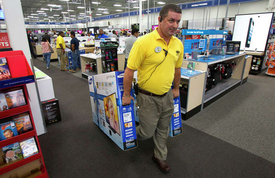Scott Saulsbury moves TVs to the front of the store during Black Friday at Best Buy Friday, Nov. 23, 2012, in Houston. Photo: Cody Duty, . / © 2012 Houston Chronicle