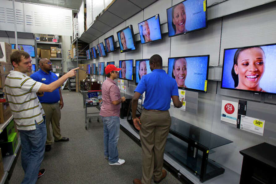 Customers look at TVs at Best Buy during Black Friday, Nov. 23, 2012, in Houston.
