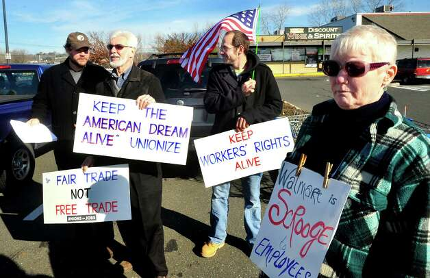 Prosters picket outside Walmart in Danbury during a demonstration Friday, Nov. 23, 2012. From left are Joe Hill, Mike Toto, Steve Navarra and Mary Lou Johnston. Photo: Michael Duffy / The News-Times