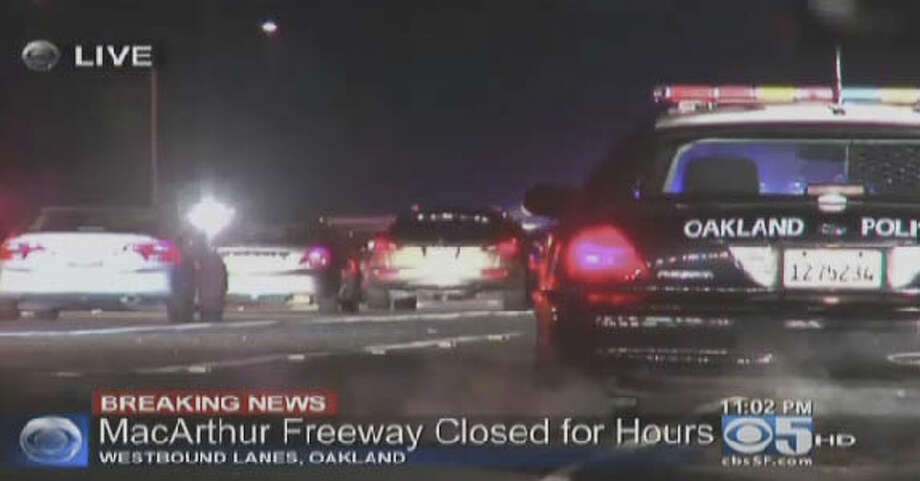 Police closed westbound lanes of Interstate 580 in East Oakland Wednesday night following reports of a gun battle between two cars. Photo: CBS San Francisco