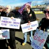Prosters picket outside Walmart in Danbury during a demonstration Friday, Nov. 23, 2012. From left are Joe Hill, Mike Toto, Steve Navarra and Mary Lou Johnston.