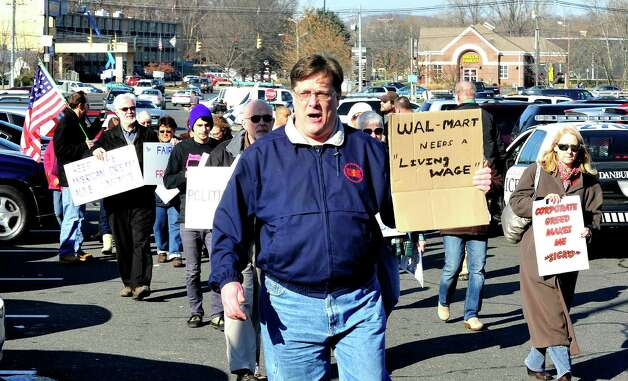 Prosters, including John Woodruff, center, picket outside Walmart in Danbury during a demonstration Friday, Nov. 23, 2012. Photo: Michael Duffy / The News-Times