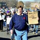 Prosters, including John Woodruff, center, picket outside Walmart in Danbury during a demonstration Friday, Nov. 23, 2012.