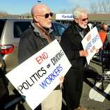 Prosters picket outside Walmart in Danbury during a demonstration Friday, Nov. 23, 2012.