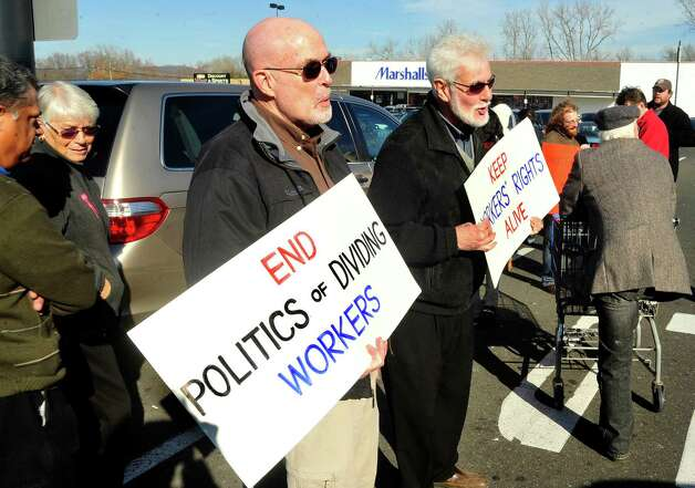 Prosters picket outside Walmart in Danbury during a demonstration Friday, Nov. 23, 2012. Photo: Michael Duffy