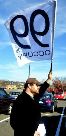 Prosters, including Justin Molito, picket outside Walmart in Danbury during a demonstration Friday, Nov. 23, 2012. Photo: Michael Duffy