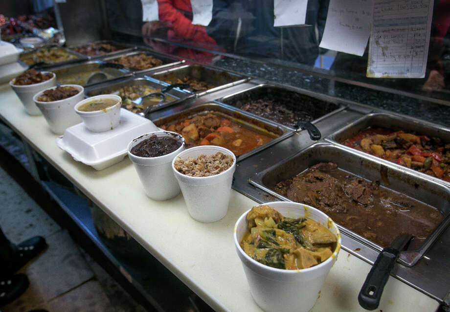 Food waiting for take-out at Fil-Am Cuisine in Daly City. Photo: John Storey, Special To The Chronicle / John Storey