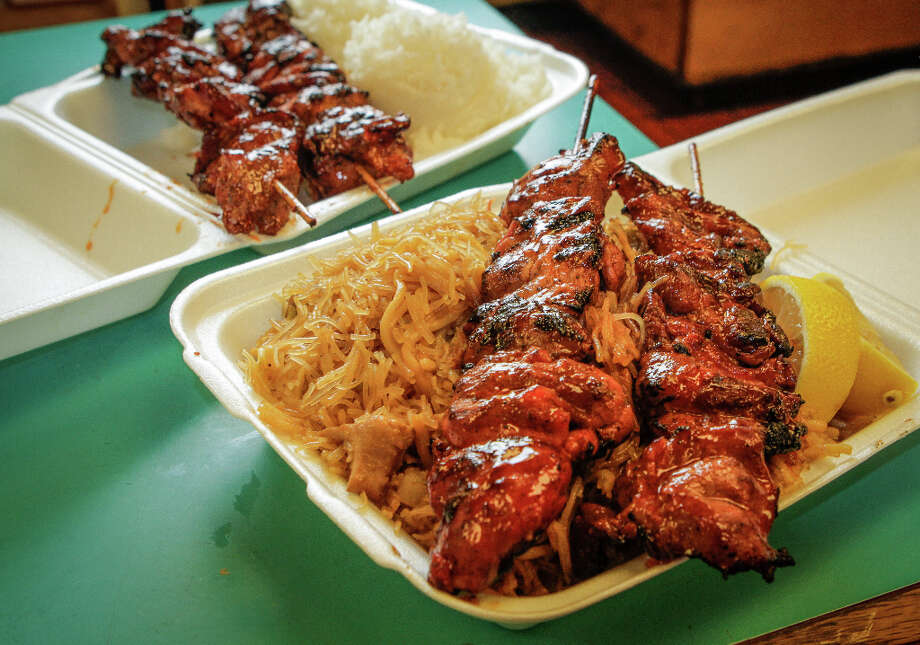 A BBQ Pork skewer with noodles and a Chicken skewer with rice at Fil-Am Cuisine in Daly City. Photo: John Storey, Special To The Chronicle / John Storey