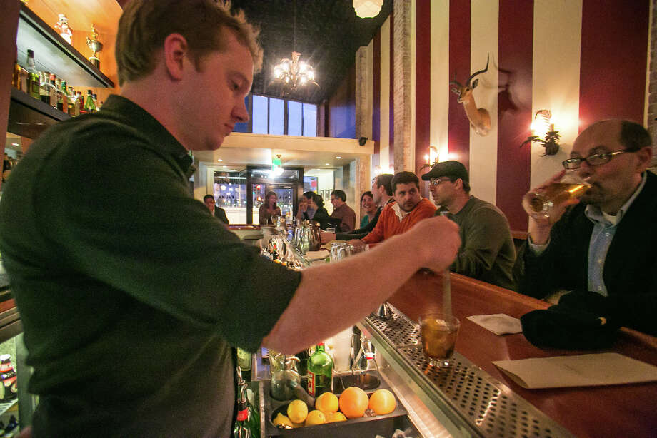 Bartender Liam Gilmore mixes a Mulwray Old Fashioned at Fauna. Photo: John Storey, Special To The Chronicle / John Storey