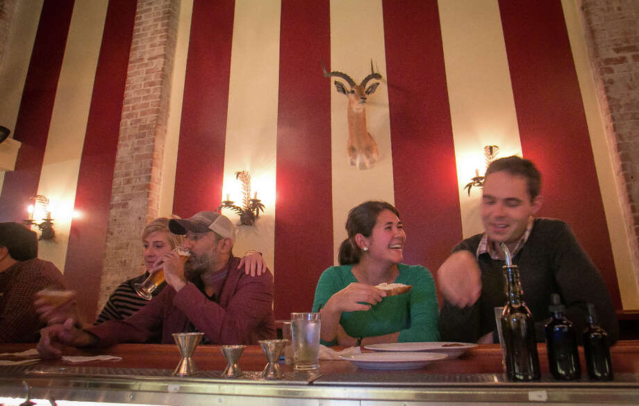 People enjoy happy hour at Fauna. Photo: John Storey, Special To The Chronicle / John Storey