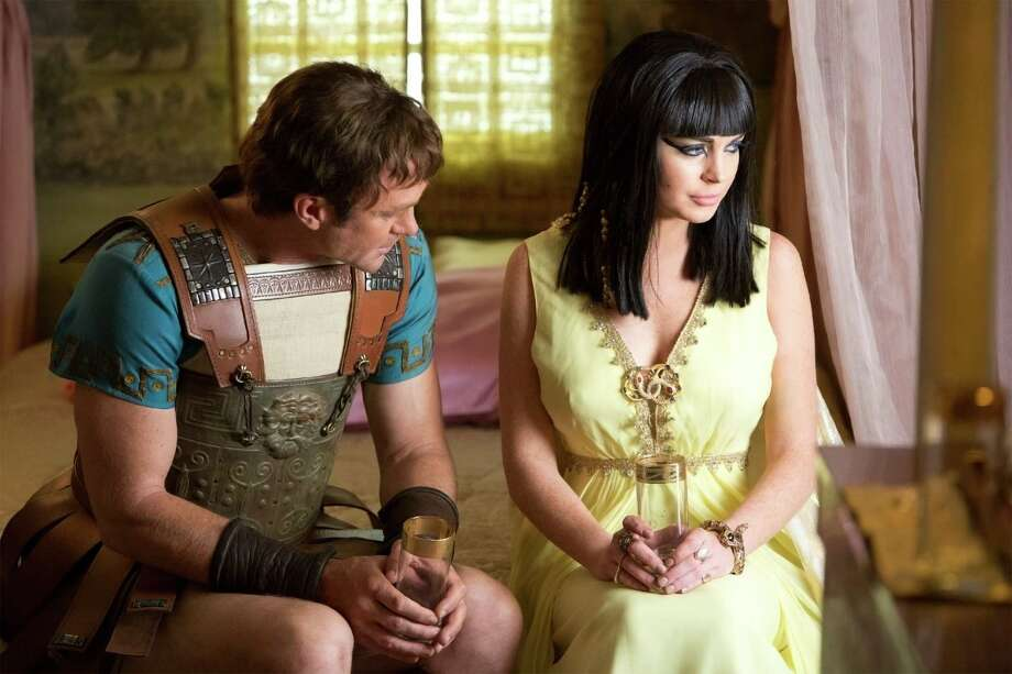 "Richard Burton (Grant Bowler) and Elizabeth Taylor (Lindsay Lohan) fell in love on the set of ""Cleopatra,"" setting off media frenzy, as seen in ""Liz & Dick."" Photo: Lifetime"
