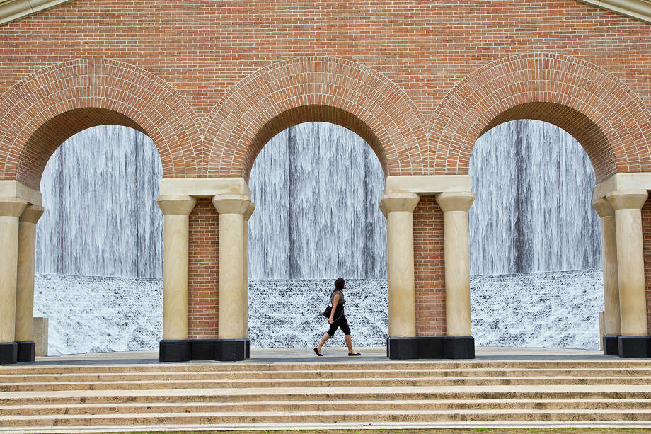 The Water Wall, built by Architect John Burgee with Philip Johnson, stands near the Williams Tower, once called the Transco Tower, in Houston's Galleria area. The wall sits on 3 acres, and 11,000 gallons of water per minute spill over the 64-foot walls. Photo: Kathy Adams Clark / Kathy Adams Clark/KAC Productions