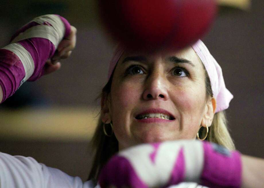 Christy Martin was stabbed and shot by her husband in 2011, just months later she was scheduled to return to the ring.  Photo: Julie Jacobson, AP / AP
