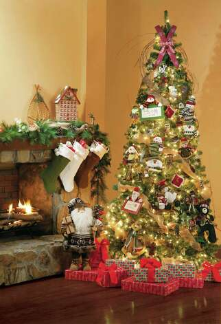 Christmas tree experts say you should not place your tree next to a fireplace or other source of heat. Photo: Associated Press /  Jo-Ann Stores, Inc.