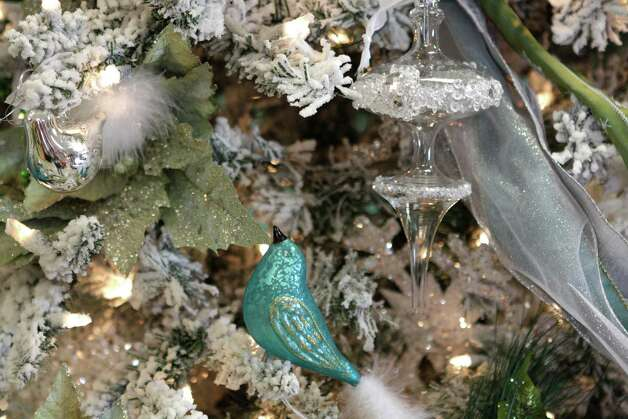 Silver, white and turquoise dress the Marie Antoinette-themed Christmas tree at Cornelius Nursery in Houston. Photo: Melissa Phillip, Staff / © 2012 Houston Chronicle