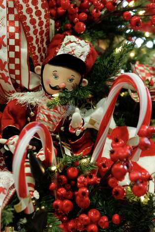 A nutcracker ornament fits right in on the Peppermint With a Twist-themed tree. Photo: Melissa Phillip, Staff / © 2012 Houston Chronicle