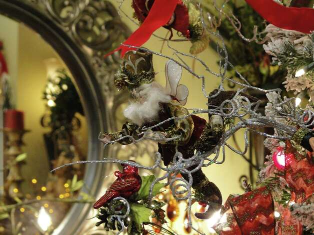 A Mark Roberts Christmas Fairy hangs on a tree at Silk Greenery on Lockhill-Selma Road. Store manager and floral designer Sherry Pan likes to hang ornaments from branches she inserts into the tree for added dimension. Photo: Tracy Hobson Lehmann