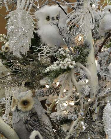 Snow, ice and owls combine for a serene woodland theme on a tree at Silk Greenery on Lockhill-Selma Road. The small flocked tree is hidden beneath all the embellishments. Photo: Tracy Hobson Lehmann