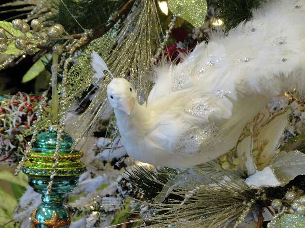 Peacocks and their jewel tones are decorating trees this Christmas. Photographed at Silk Greenery on Lockhill-Selma Road. Photo: Tracy Hobson Lehmann