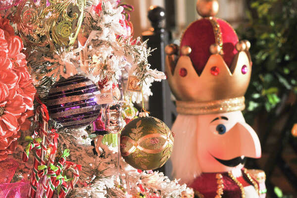 Colorful ornaments brighten what manager Tracy Navarro calls their Katy Perry Christmas tree at Summer Classics at 2600 Broadway.
