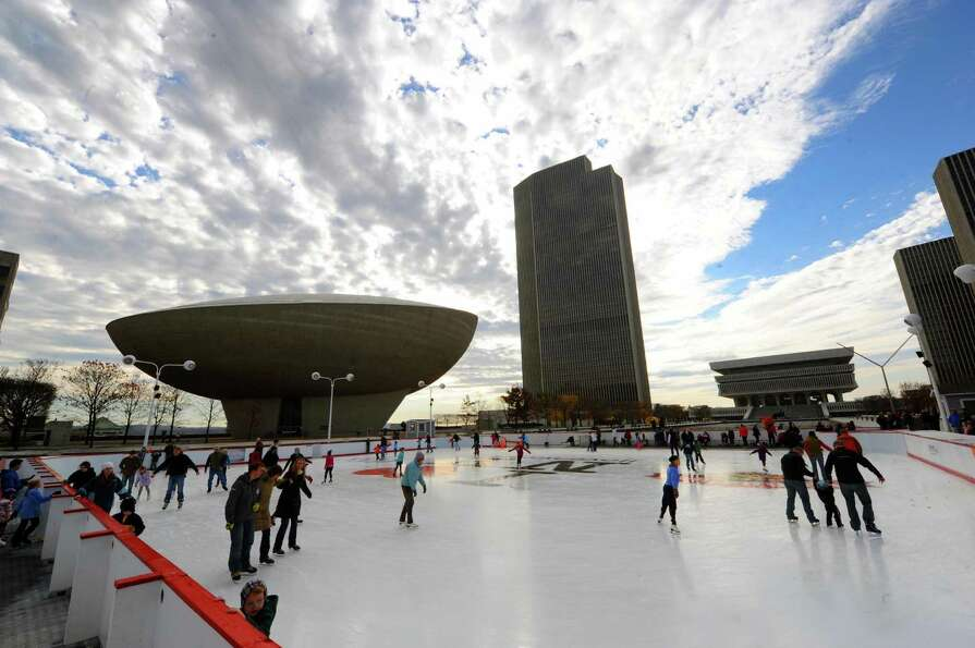 Skaters hit the ice on the opening day of the Empire State Plaza ice rink in Albany, NY, on Friday,