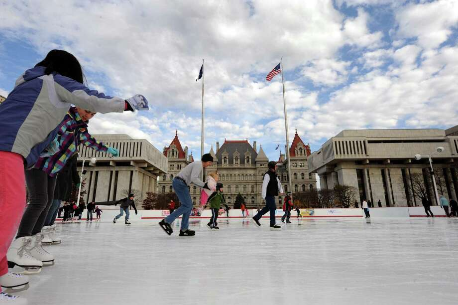 Skaters hit the ice on the opening day of the Empire State Plaza ice rink in Albany, NY, on Friday, Nov. 23, 2012. (Michael P. Farrell/Times Union) Photo: Michael P. Farrell