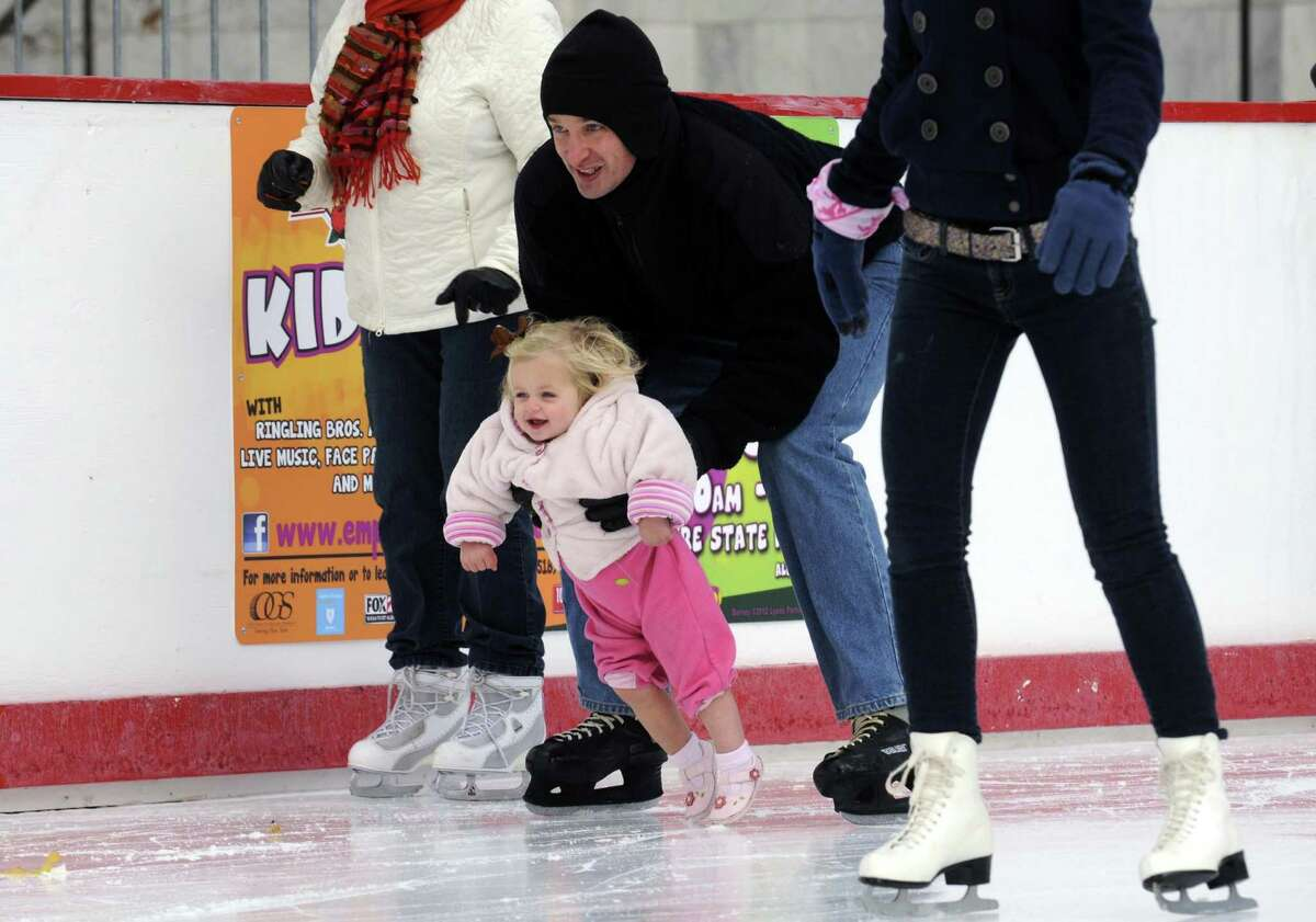 Nate Henderson holds his one-year-old daughter Hadley Henderson as he skates at the Empire State Plaza ice rink in Albany, NY Friday Nov. 23, 2012. (Michael P. Farrell/Times Union)