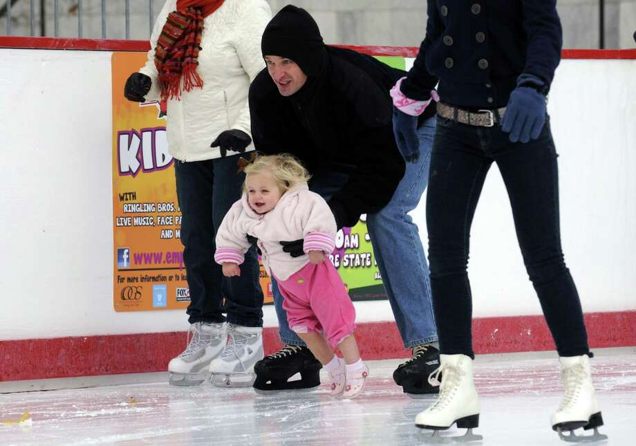 Nate Henderson holds his one-year-old daughter Hadley Henderson as he skates at the Empire State Plaza ice rink in Albany, NY Friday Nov. 23, 2012. (Michael P. Farrell/Times Union) Photo: Michael P. Farrell